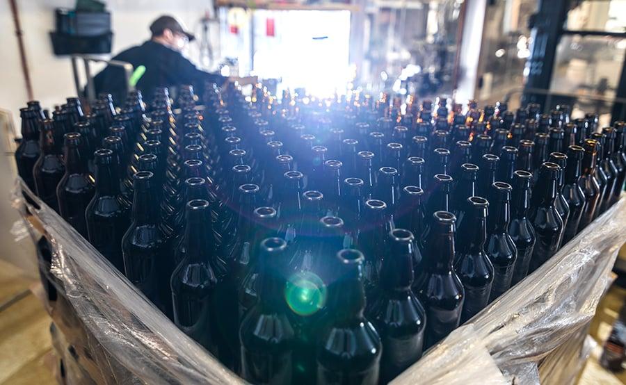 stack-of-empty-beer-bottles-P5UFAMF